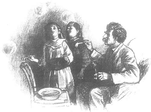 Clemens blowing bubbles with his daughters